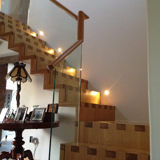 stairs and glass banister by valleybuild